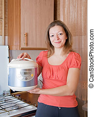 Woman with electric crock pot - Woman with electric crock...