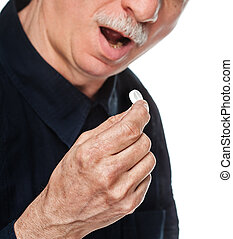 Old man wants to take a pill. Focus on hand