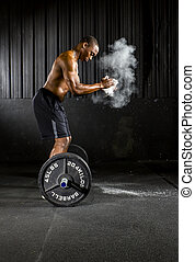 Crossfit Training - Young athlete trains with crossfit...