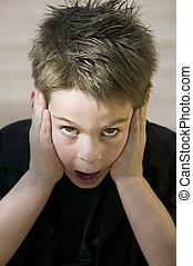 Surprised Boy - Close up of a surprised young boy with his...