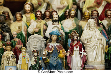 Saints and Jesus Christ on an Altar - Many statues of jesus...