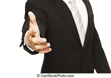 Business Handshake - A man in a business suit offering a...
