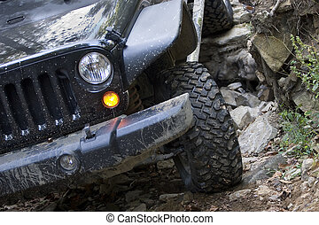 Off Road Vehicle Front End Driving - Headlight and grille on...