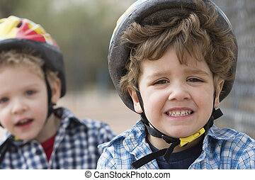 Little boys in a bicycle helmets - Two little boys in...