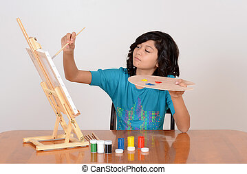 Young child painting - Young female child painting