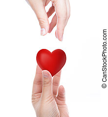 Red heart in woman hand