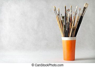 Paint Brushes - Art paint brushes in cup with empty room for...