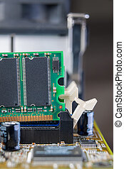 Memory module being removed - A memory module in a PC is...