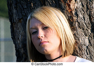 Wary Blond - Closeup of a wary young blond woman, standing...