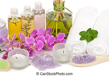Spa scene with aromatherapy, massage oil, bath salt, orchid...