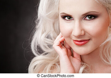 studio shot of a young, beautiful, blonde woman