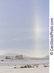 Sun dog in winter landscape in Colorado.