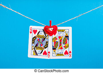 King and Queen of Hearts isolated with clothes peg rope over...