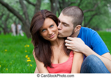love couple boy kiss a girl in the park