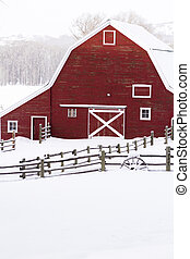 Red barn in snow on lamb farm