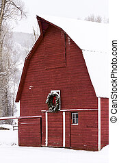 Red barn in snow on the farm in Colorado