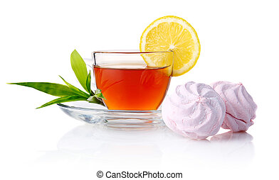 Cup of black tea with lemon, green leaves and marshmallow isolated on white background