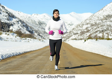 Woman running on winter road