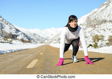 Woman run in winter landscape road