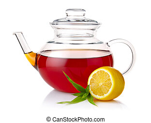 Teapot with black tea, green leaves and lemon slices isolated on white background
