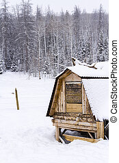 Chicken coop in snow on a small farm