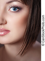 Close-up portrait of young beautiful woman with clear make-up and perfect healthy skin