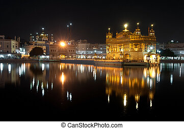 Night view of Amritsar Golden Temple, India - Amritsar...