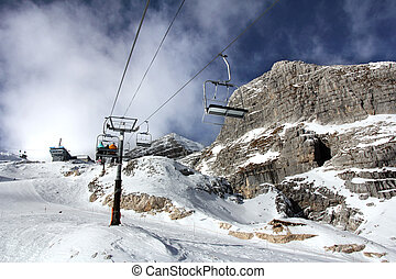 Cablecar - Ski-lift transports skiers to the top of the...