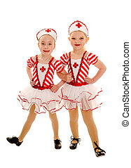 Young Tap Dancing Nurse Buddies - Two Happy Little Girl...