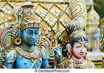 Shiva with his wife Parvati on traditional Hindu temple,...