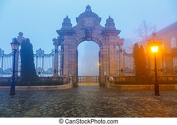 Gate to Buda Castle, Budapest - Buda castle at foggy...