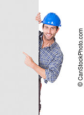 Portrait of happy worker presenting empty banner Isolated on...