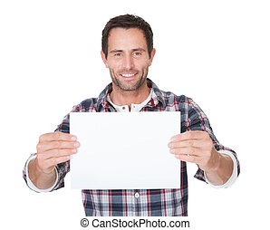 Happy middle age man presenting empty paper Isolated on...