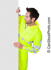 Happy worker wearing safety jacket