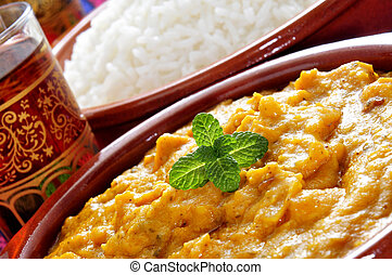 korma curry and basmati rice - closeup of some bowls with...