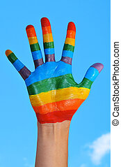 gay hand - someone showing the palm of his hand painted as...