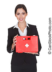 Happy Businesswoman Holding First Aid Box Isolated On White