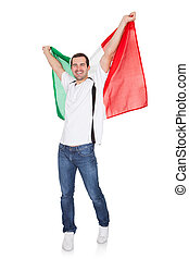 Portrait Of A Happy Man Holding An Italian Flag. Isolated on...