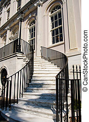 White Marble Steps Between Black Iron Banister