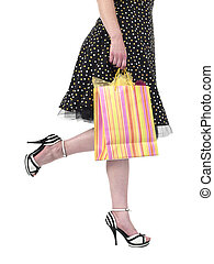 cropped image of a woman holding shopping bag and walking -...