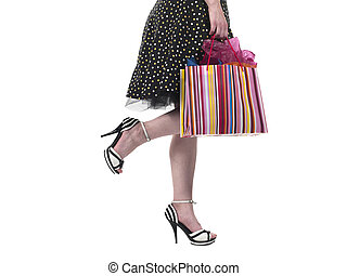 cropped image of a woman holding shopping bags - Cropped...