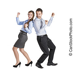 Business couple - Successful business couple is standing on...