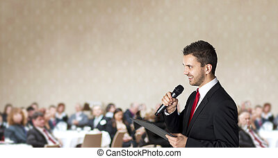 Business conference - Man is speaking on indoor business...