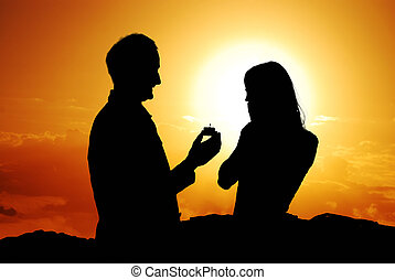 Proposal scene - Romantic proposal scene with happy woman...