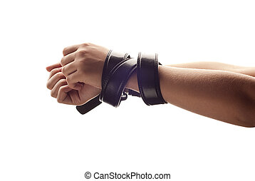 Slavery - Hands of woman are tied up by belt
