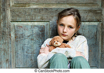Sad little girl feels lonely.