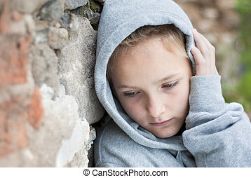Sad child - Little sad child with hoody.