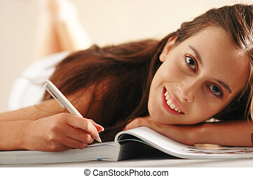 Young girl - An young pretty attractive girl with book