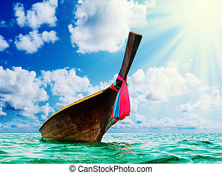 Longtail boat on the sea tropical beach - Beautiful image...