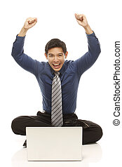 Excited Businessman - An ecstatic businessman in front of a...